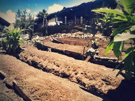 Terraces are dug and long boards are placed for a family garden.