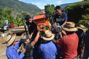 Farmer members of the non-profit ASO-Ixil Association work together to transport and install the pulpero